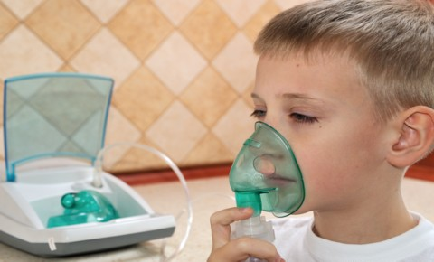 Child using an inhealer during an Asthma attck